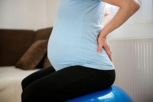 15 недель беременности болит спина