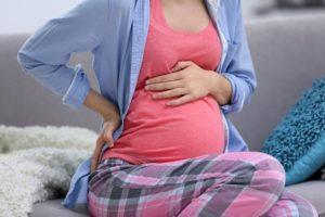 Тяжесть в животе при беременности во втором триместре